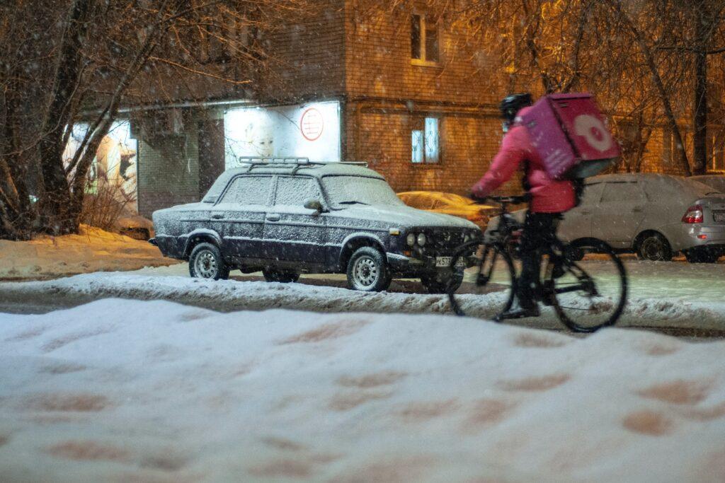 snowy bike courier